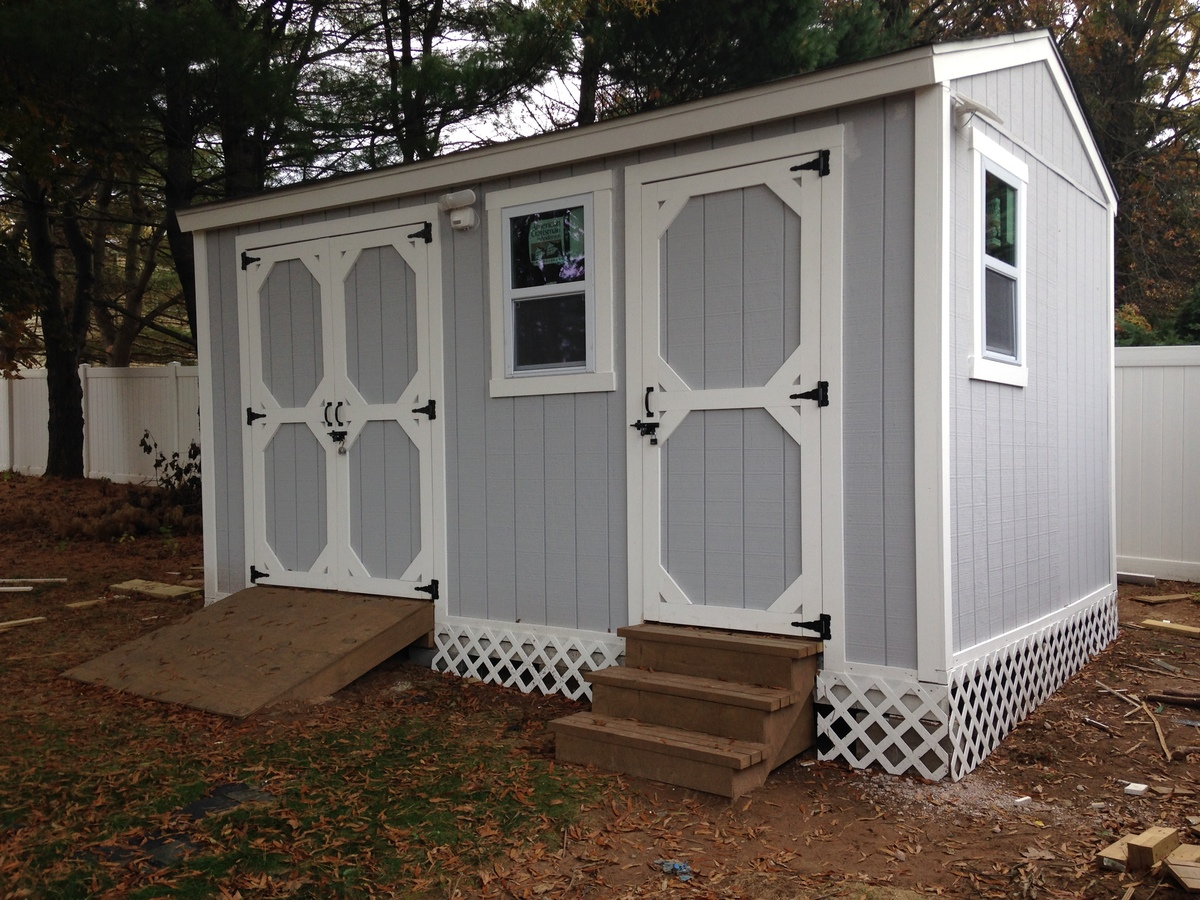 DIY storage shed with mower ramp and steps | Ana White