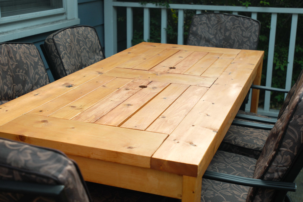 Patio Table with Built-in Beer/Wine Coolers with lids covered
