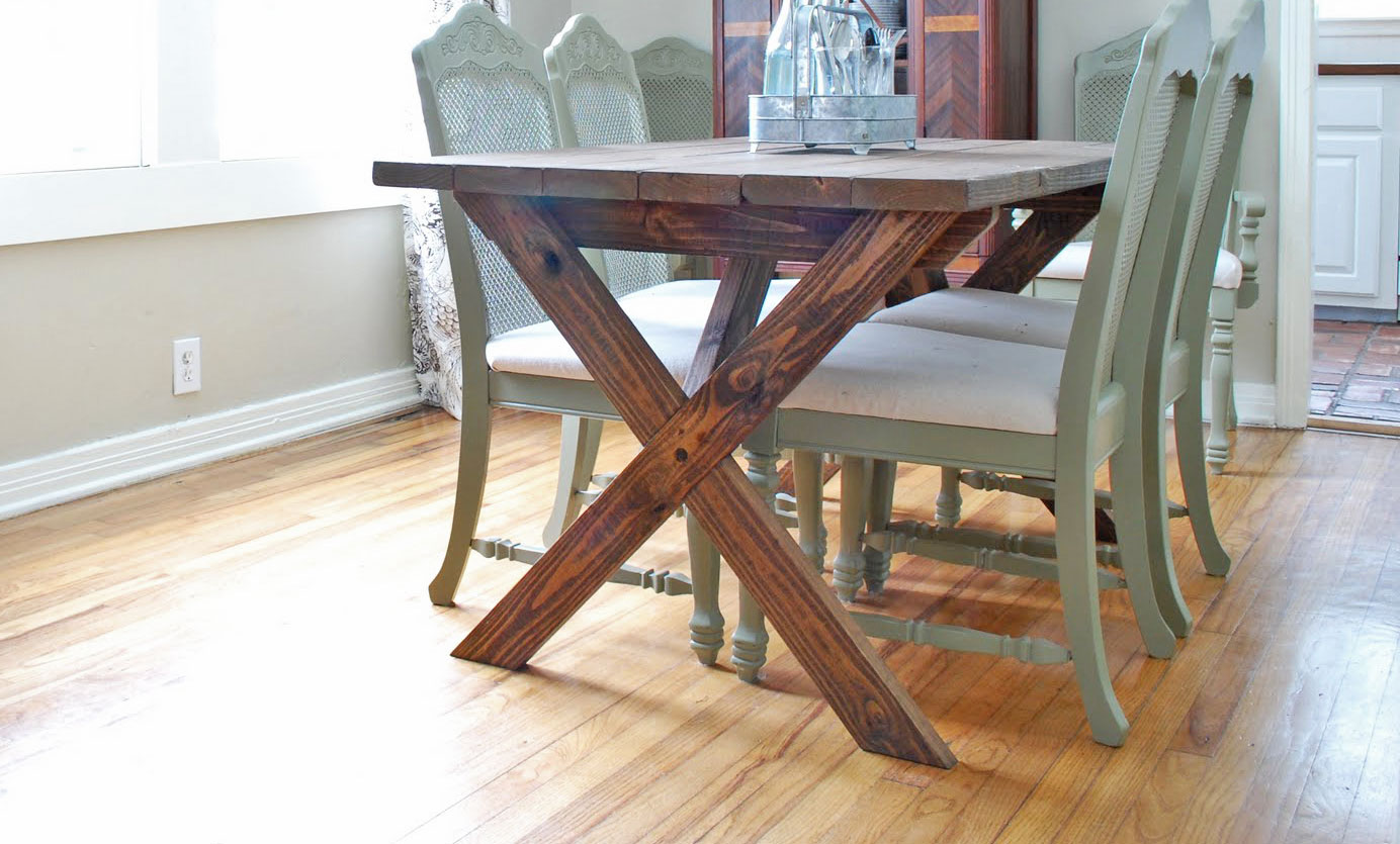 dark stained rustic X table in a pretty dining room