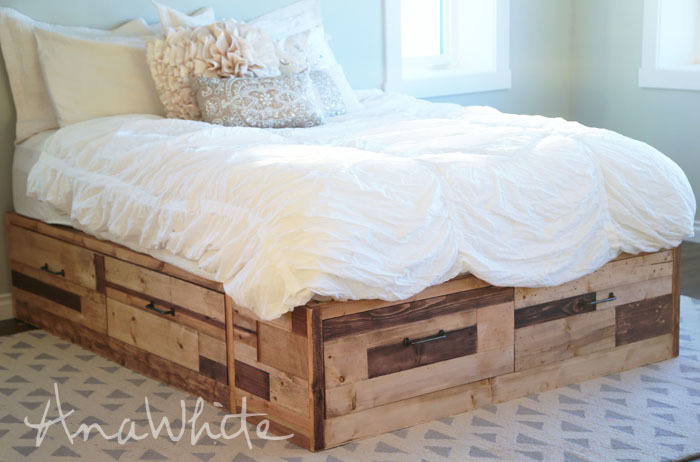 DIY Storage bed covered in scrap wood pieces.