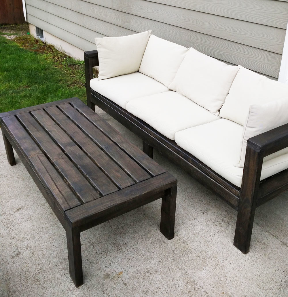 outdoor sofa stained chocolate brown with white cushions and matching coffee table