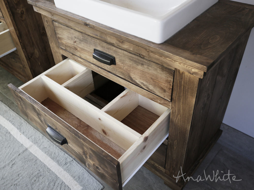 bathroom vanity with drawer open showing custom drawer fit around the plumbing