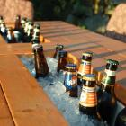 Patio Table with Built-in Beer/Wine Coolers with beer
