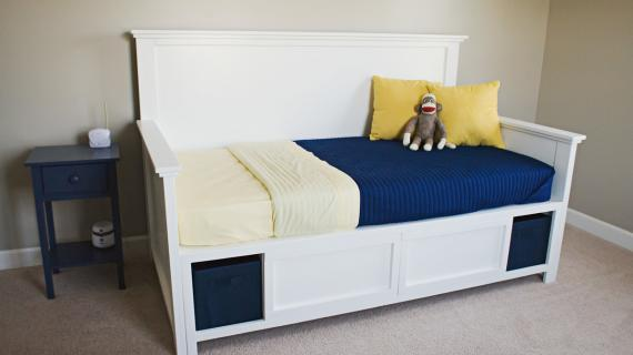 white daybed with storage compartments