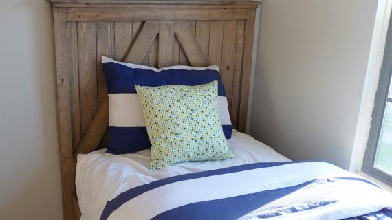 rustic farmhouse headboard with cross detailing