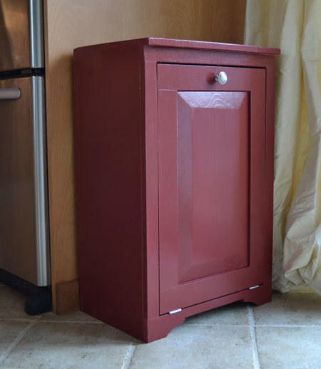 wood trash bin cabinet painted red with door closed
